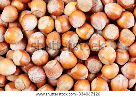 A heap of hazelnuts viewed from above - stock photo