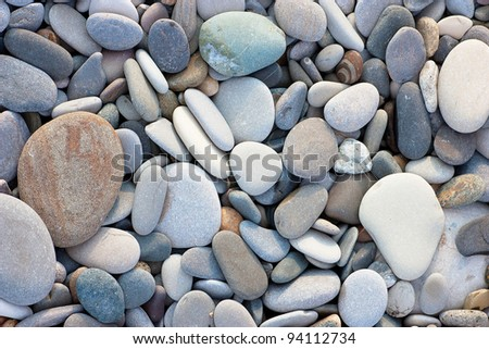 A heap of pebbles. Abstract background - stock photo