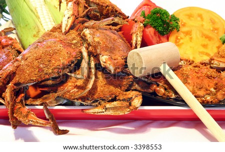 A heaping plate of fresh steamed crabs, corn and tomatoes