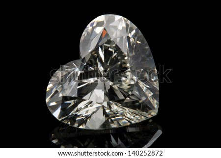 A heart cut of diamond isolated on black background.