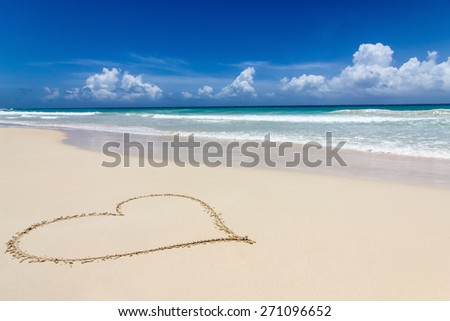 a heart in the sand on a beautiful beach - stock photo