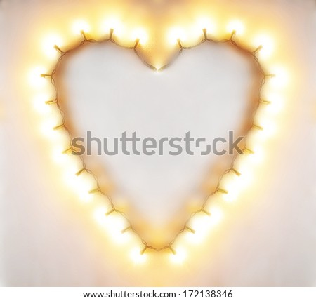 a heart in the shape of lights - stock photo