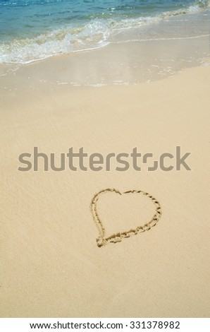 A Heart is Drawn in the Sand of a Beach in Cancun Paradise With Copy Space - stock photo