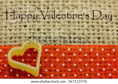 a heart lies on fabric - stock photo