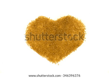 A heart made of brown sugar on a white background - stock photo