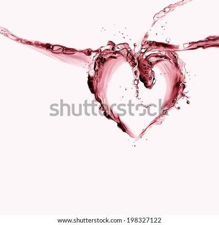 A heart made of red liquid splashing.  - stock photo