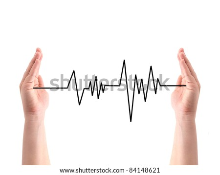 A heart rate line between two hands - stock photo