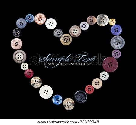 A heart shape made of old 4-hole buttons, isolated on black with sample text (that you can change or delete) inside the heart