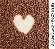 A heart symbol made from coffee crops on handmade paper - stock photo