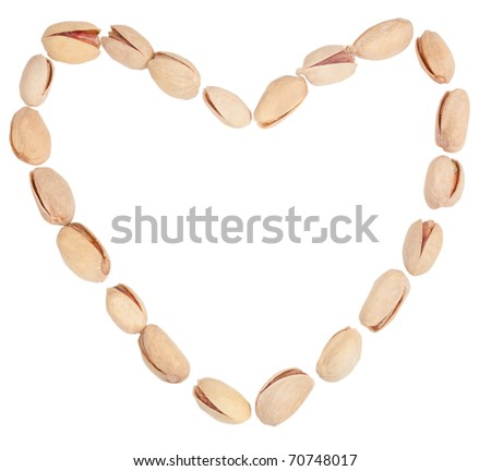 a heart with pistachio isolated on the white background