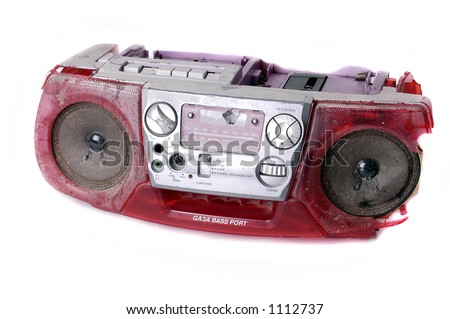 A heavily battered and broken portable stereo unit, assaulted and disabled by marauding MP3 players - stock photo