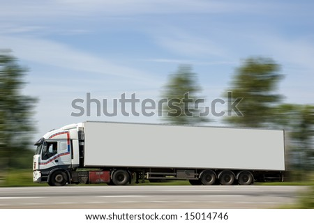 A heavy truck hurries to deliver a load on purpose. - stock photo