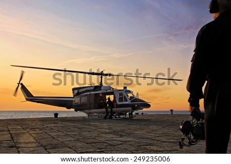 A helicopter department divers prepares for takeoff on the platform of an Italian port. unfocused - stock photo