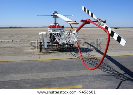 A helicopter used for crop spraying is parked on the ramp - stock photo
