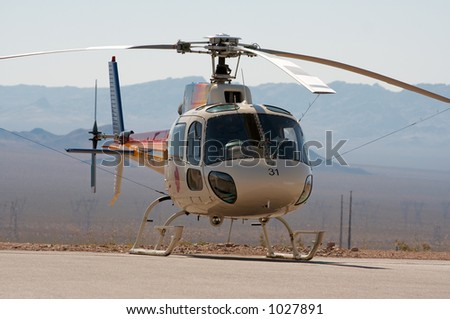 A helicopter with a dessert background. - stock photo