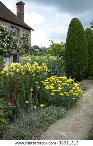 A   herbaceous border in an English cottage garden - stock photo