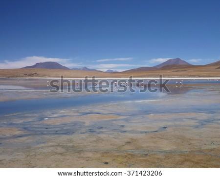 a high altiplano sulphuric lake in bolivia - stock photo
