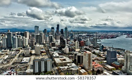 A high altitude HDR view of Seattle skyline and Port of Seattle on a cloudy day. - stock photo
