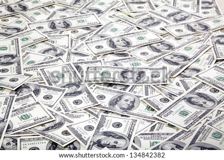 A high angle view of a very large amount of 100 US$ money notes in a bulky mess.