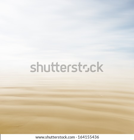 A high-key, abstract seascape with blurred water movement and subtle, pastel colors. - stock photo