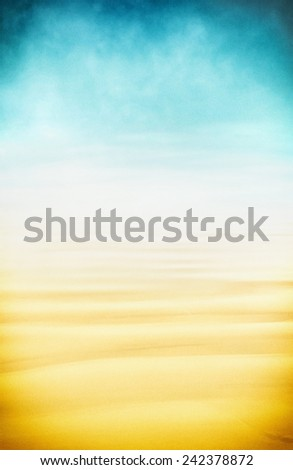 A high-key seascape of sand, fog and sky.  Image displays a pleasing paper grain and texture at 100 percent. - stock photo