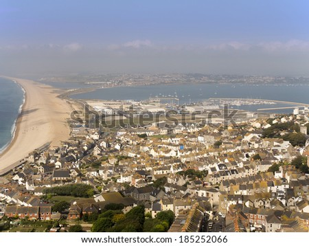 a high level view of chesil beach from the isle of portland dorset - stock photo