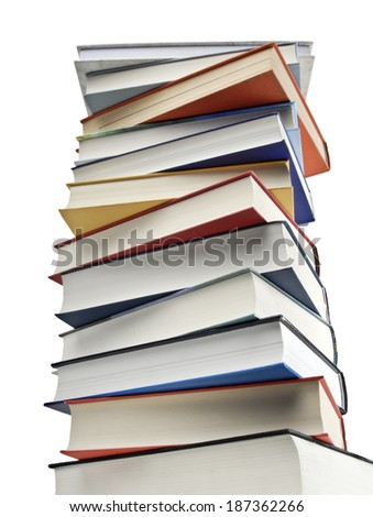 A high pile of books isolated on white - stock photo