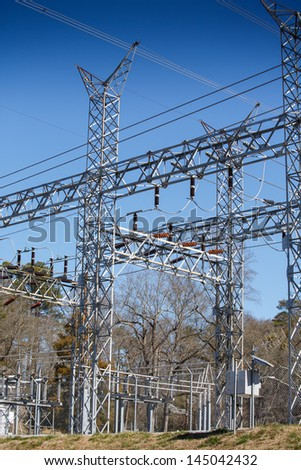 A high power substation under a clear blue sky