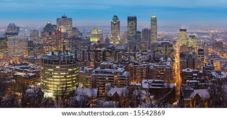 A high resolution panoramic view of downtown Montreal during winter as viewed from Mount Royal at dusk.