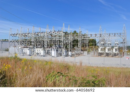 A high voltage substation - stock photo