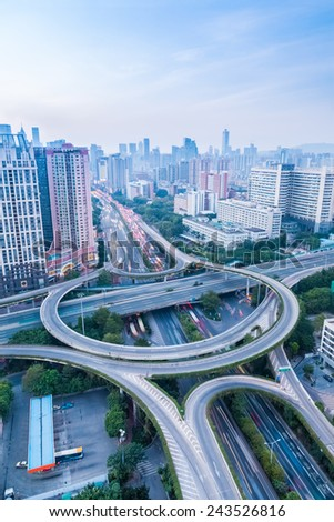 a highway interchange in guangzhou at dusk with vehicles motion blur - stock photo