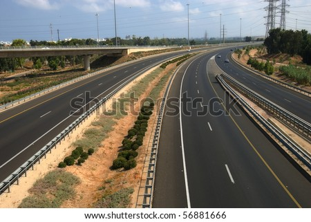 A highway junction with overpass - stock photo