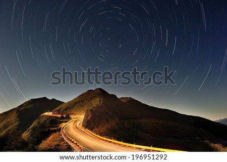 A highway lit up with lights at night time. - stock photo