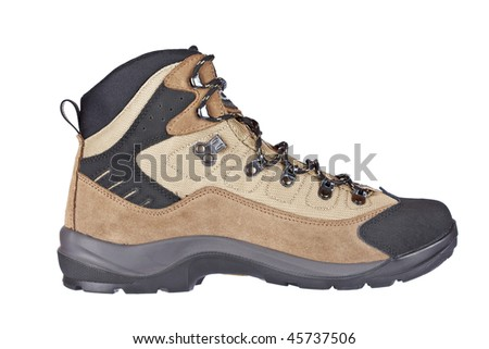 A hiking boot isolated on white background. Shallow depth of field - stock photo