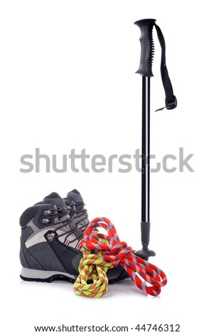 A hiking pole, pair of boots and two ropes reflected on white background - stock photo
