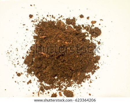 A hill of soil isolated on a white background