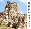 A hill showing Uchisar Castle cave houses in Cappadocia, central Turkey - stock photo