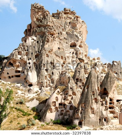 A hill showing Uchisar Castle cave houses in Cappadocia, central Turkey