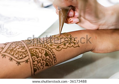 A Hindu Bride has Henna applied to her hands - stock photo