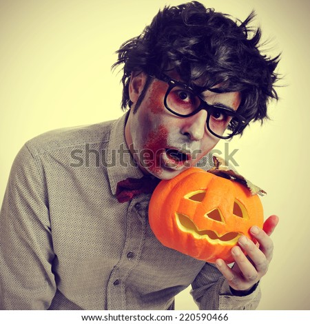 a hipster zombie with a jack-o-lantern, with a retro effect - stock photo