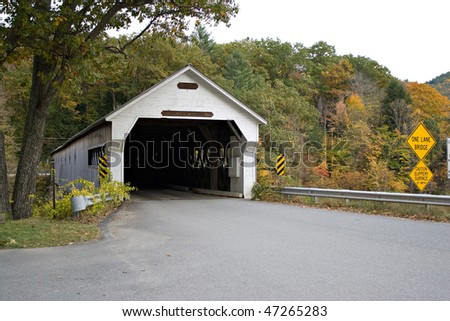 A historic New England covered bridge located in Dummerston Vermont. - stock photo