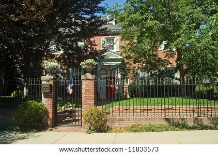 A historical mansion in Denver's wealthy country club district greets passers by - stock photo