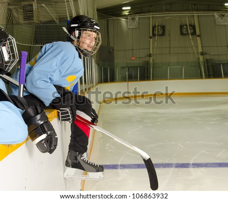 A Hockey Player on the Bench at the Rink is Ready to Jump on the Ice and Play - stock photo
