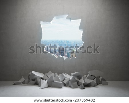 A Hole in a concrete wall with city view - stock photo