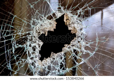 a hole in the window pane - stock photo