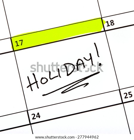 A holiday date highlighted on a Calendar. - stock photo