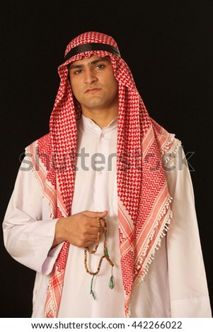 A holy man reciting the Quran/Ramadan Kareem - stock photo