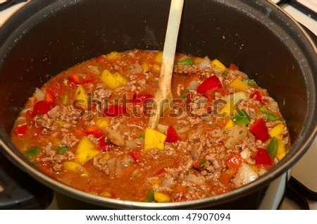 A home made bolognese souce simmering away - stock photo