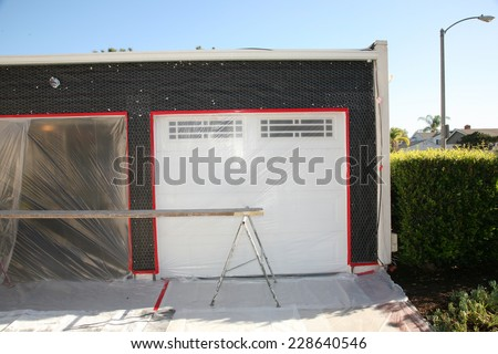 a home remodeling project. a home has its walls removed and replaced with new wood, tar paper, wire, stucco and paint to make an old house New Again. Remodeling is cheaper than buying a new home - stock photo