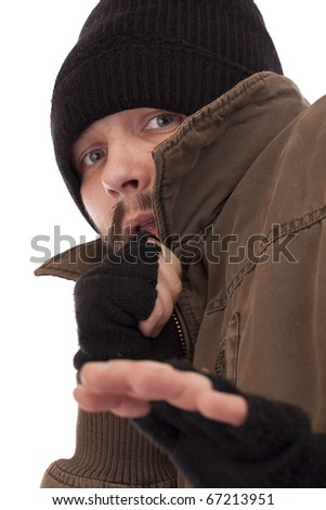 A homeless man afraid and scared - stock photo